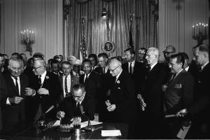 Lyndon Johnson at the signing of the Civil Rights Act on July 2nd 1964 with Martin Luther King Jr present.